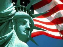 statue_of_liberty_with_us_flag_wallpaper_-_1024x768.jpg