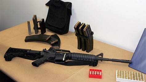A Bushmaster AR-15 semi-automatic rifle and ammunition is seen in Seattle, March 27, 2006. (Ted S. Warren/AP Photo)