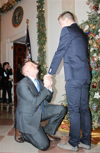 The American Military Partner AssociationU.S. Marine Corps captain Matthew Phelps gets down on one knee to propose to partner Ben Schock on Saturday night in the first same-sex marriage proposal at the White House.