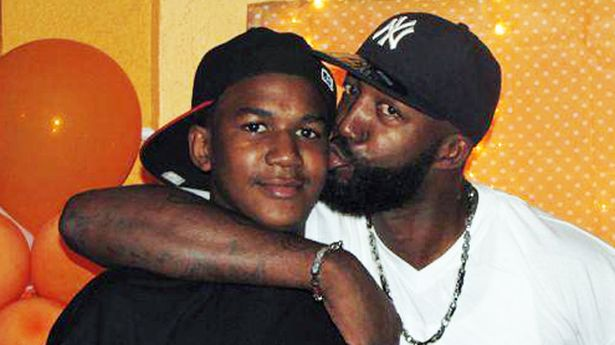 Murdered Trayvon Martin and his father