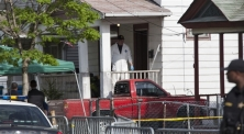 John Makely / NBC News An FBI investigator exits the house on Seymour Ave.