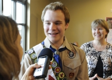 Michael Prengler / Reuters Pascal Tessier, 16, from Kensington, Md., an openly gay scout who was facing expulsion from the Boy Scouts, answers questions from the media while his mother, Tracie Felker, looks on.