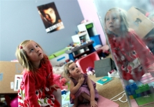 Brennan Linsley / AP file With her face reflected in a mirror, Coy Mathis, left, a transgender girl, plays with her sister, Auri, 2, center, at their home in Fountain, Colo., on Monday, Feb. 25, 2013. Coy's parents are suing the Fountain-Fort Carson School District 8 after she was denied access to a girl's bathroom at her elementary school.