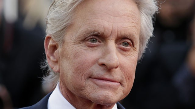 Actor Michael Douglas poses for photographers as he arrives for the screening of Behind the Candelabra at the 66th international film festival, in Cannes, southern France, in this May 21, 2013. (David Azia/AP Photo)