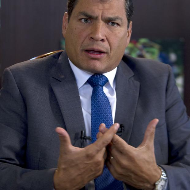 """Ecuador's President Rafael Correa, speaks during a interview with The Associated Press in Portoviejo, Ecuador, Sunday, June 30, 2013. Correa said he had no idea Snowden's intended destination was Ecuador when he fled Hong Kong for Russia last week. He said the Ecuadorean consul in London committed """"a serious error"""" without consulting any officials in the capital, Quito, when the consul issued a letter of safe passage for Snowden. (AP Photo/Martin Mejia)"""