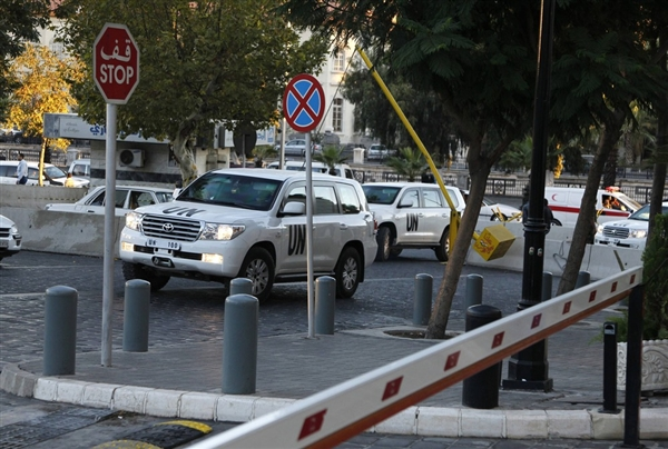 Khaled Al-Hariri / Reuters U.N. vehicles transporting a team of experts from the Organization for the Prohibition of Chemical Weapons (OPCW) return to their hotel in Damascus on Oct. 6.