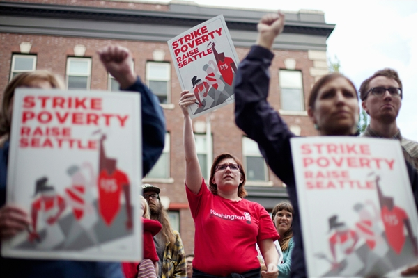 David Ryder / Reuters Joelle Craft, center, holds a sign during a rally and strike aimed at the fast-food industry and the minimum wage in Seattle.