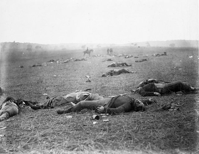 """""""It was, indeed, a 'harvest of death',"""" wrote photographer T.H. Sullivan in the caption to this photo he took of the rotting dead at Gettysburg in July 1863.  