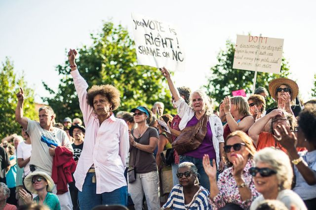 A crowd of thousands cheer in support during a speech by Rev Dr. William Barber II, president of the North Carolina NAACP in Asheville, NC's Pack Square Park during Mountain Moral Monday on Aug 5, 2013.PHOTO BY MIKE BELLEME FOR MSNBC