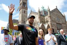 PHOTO BY MARY SCHWALM/AP NBA veteran Jason Collins, left, marches in Boston's gay pride parade, June 8, 2013.