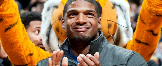 Missouri's All-American defensive end Michael Sam claps during the Cotton Bowl trophy presentation, Feb. 15, 2014, in Columbia, Mo.L.G. PATTERSON/AP