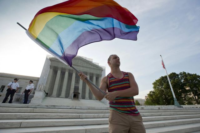 Gay rights advocate Vin Testa in front of the Supreme Court. The prospect of a monumental ruling on same-sex marriage dominates expectations of the coming session. (J. Scott Applewhite/AP)