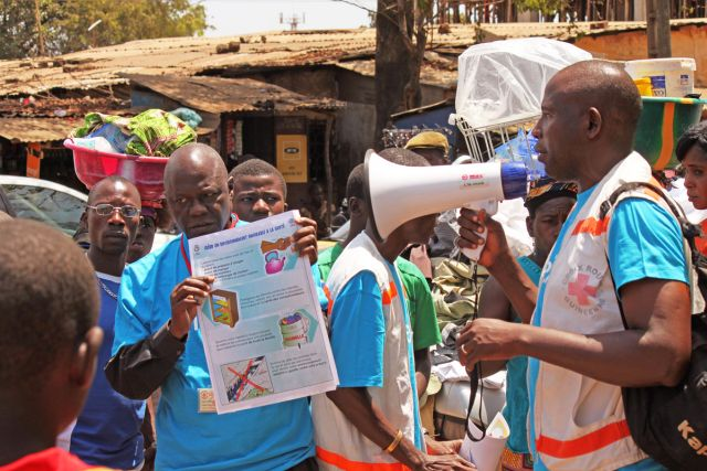 Health workers teach people about the Ebola virus and how to prevent infection, in Conakry, Guinea, on March 31, 2014. (Youssouf Bah/AP)