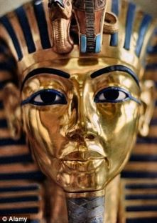 TUT 1413756825299_wps_11_The_gold_burial_mask_of_T
