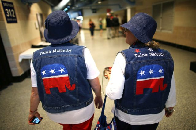 Two attendees wear GOP logo cut-off jean jackets during the third day of the Republican National Convention on Aug. 29, 2012 in Tampa, Florida. Chip Somodevilla/Getty