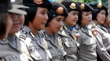 Indonesian policewomen stand guard during an anti-government protest in Jakarta on March 29, 2012