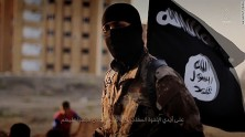 "ISIS fighter orchestrates the mass execution of a group of men in an ISIS recruitment video called ""Flames of War."""