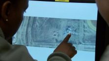 Analysts look over a satellite image to locate an ISIS target CBS NEWS