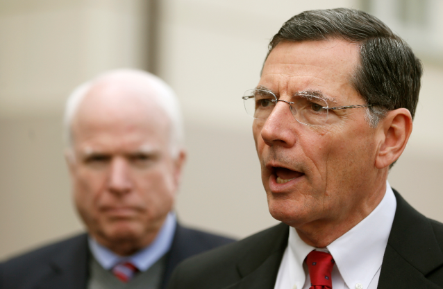 This April 16, 2014, file photo shows Sen. John Barrasso, R-Wyo., right, joined by Sen. John McCain, R-Ariz., as he speaks to media in Vilnius, Lithuania. CREDIT: AP PHOTO/MINDAUGAS KULBIS
