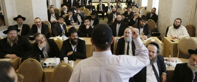 Rabbis take part in a first aid training during the Conference of European Rabbis in Prague, Czech Republic, Tuesday, Feb. 24, 2015. Due to the recent attacks on Jewish communities in Europe, part of the conference was a self defense and first aid training. (AP Photo/Petr David Josek)   ASSOCIATED PRESS