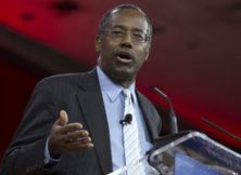 Ben Carson (pictured Feb. 26) has an invitation from columnist Dan Savage to prove being gay is a choice.
