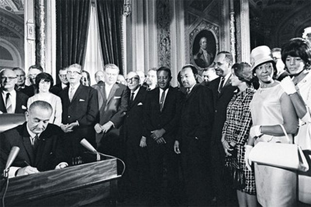 President Lyndon B. Johnson signs the 1965 Voting Rights Act