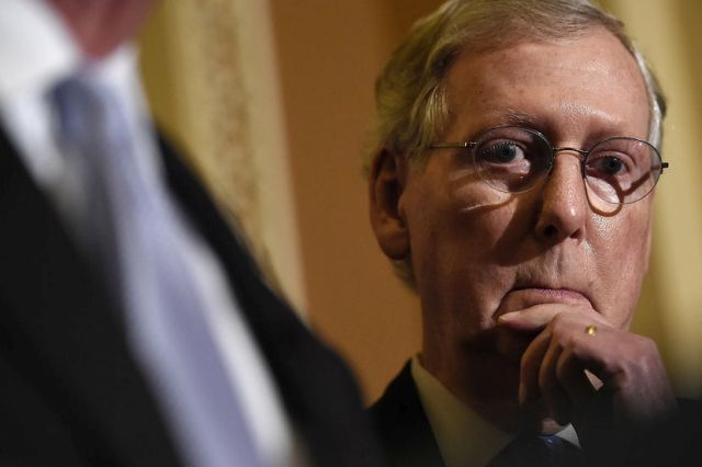Senate Minority Leader Mitch McConnell (R-KY) answers questions following the weekly Republican policy luncheon at the U.S. Capitol on Nov. 13, 2014 in Washington, DC. Win McNamee/Getty