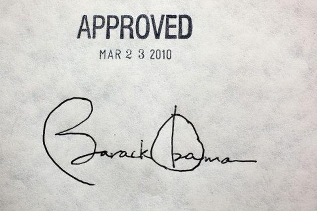 obamacare-signature-485x323