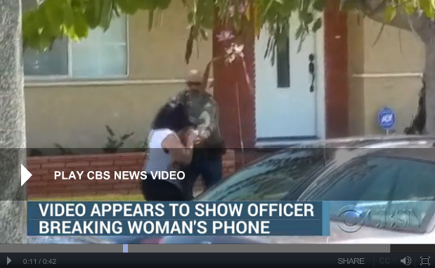 APRIL 21, 2015, 8:53 PM|The U.S. Marshals service is looking into a video posted online that appeared to show an officer breaking a woman's cell phone as she tried to record video in Southern California.