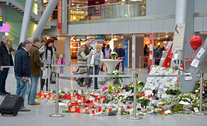Candles, flowers and other tributes formed a memorial at the airport in in Düsseldorf, Germany, the planned destination of the Germanwings flight that crashed last week, killing 150 people. Credit Martin Meissner/Associated Press