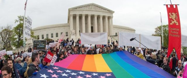 Protesters hold a pro-gay rights flag outside the US Supreme Court on April 25, 2015, countering the demonstrators who attended the March For Marriage in Washington, DC. The Supreme Court meets on April 28 to hear arguments whether same-sex couples have a constitutional right to wed in the United States, with a final decision expected in June. AFP PHOTO/PAUL J. RICHARDS (Photo credit should read PAUL J. RICHARDS/AFP/Getty Images) | PAUL J. RICHARDS via Getty Images