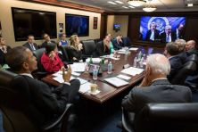 A handout picture released by the White House on April 1, 2015 shows President Obama and Vice President Biden, with the national security team, participating in a secure video teleconference from the Situation Room of the White House on March 31, 2015, with Secretary of State John Kerry, Energy Secretary Ernest Moniz and the U.S. team negotiating with Iran about their nuclear program in Lausanne, Switzerland. (White House / Pete Souza/EPA)