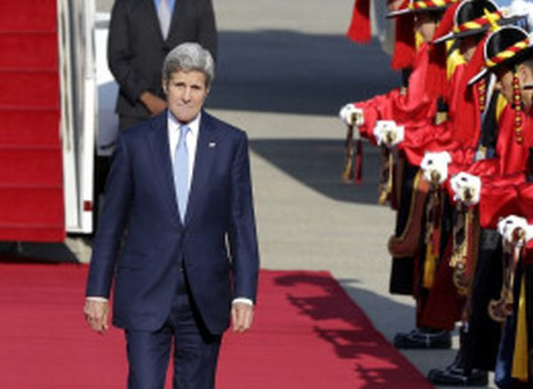 U.S. Secretary of State John Kerry inspects an honor guard upon his arrival at the Seoul Military Airport in Seongnam, South Korea, Sunday, May 17, 2015. As Kerry wrapped up a visit to China on Sunday, both sides stressed the importance of dialogue to resolve competing claims in the waterway. But neither showed any sign of giving ground over Chinese land reclamation projects that have alarmed the United States and China's smaller neighbors. (AP Photo/Ahn Young-joon)