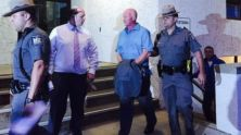 Gene Palmer, 57, an officer at the Clinton Correctional facility in Dannemora, New York, (light blue shirt) was arrested June 24, 2015, in connection with the escape of two convicted murderers who have evaded capture for weeks.