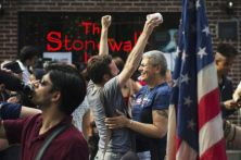 People embrace and cheer as they join a crowd celebrating the U.S. Supreme Court ruling against the Defense of Marriage Act outside the Stonewall Inn in New York June 26, 2013. The U.S. Supreme Court delivered a landmark victory for gay rights on Wednesday by forcing the federal government to recognize same-sex marriages in states where it is legal and paving the way for it in California, the most populous state.  REUTERS/Lucas Jackson (UNITED STATES - Tags: POLITICS SOCIETY) - RTX112G3