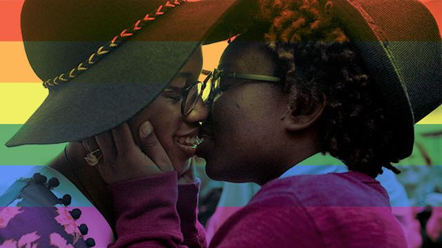 Tori Sisson (left) and Shanté Wolfe kiss after saying their marriage vows in February, in Montgomery, Alabama. Brynn Anderson/AP