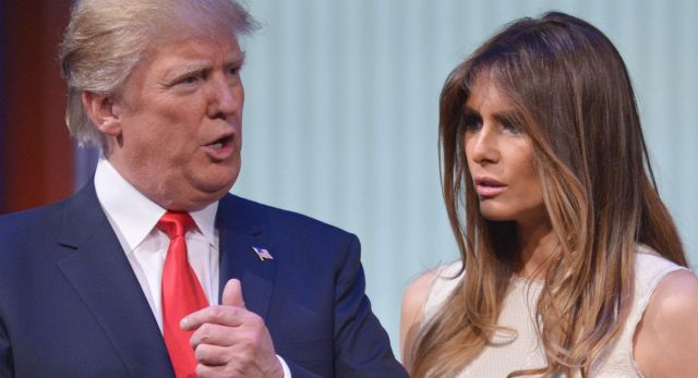 Donald Trump and his wife Melania Trump are seen on stage following the prime time Republican presidential debate on August 6, 2015 at the Quicken Loans Arena in Cleveland, Ohio. AFP PHOTO/MANDEL NGAN (Photo credit should read MANDEL NGAN/AFP/Getty Images)