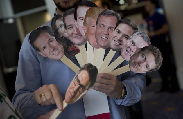 "Adam Gabbatt of The Guardian newspaper holds images of possible Republican candidates, from left, former Penn. Sen. Rick Santorum, former Alaska Gov. Sarah Palin, Sen. Ted Cruz, R-Texas, Wisconsin Gov. Scott Walker, Donald Trump, New Jersey Gov. Chris Christie, Sen. Marco Rubio, R-Fla., former Florida Gov. Jeb Bush, Sen. Rand Paul, R-Ky., and below, former Texas Gov. Rick Perry, as he interviews Howard ""Cowboy"" Woodward holds images during the Conservative Political Action Conference (CPAC) in National Harbor, Md., Thursday, Feb. 26, 2015. (AP Photo/Carolyn Kaster)"
