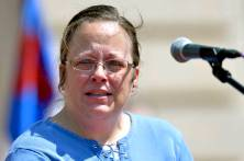 Rowan County Kentucky Clerk Kim Davis speaks to a gathering of supporters during a rally on the steps of the Kentucky State Capitol in Frankfort Ky., Saturday, Aug. 22, 2015. Davis spoke at the rally organized by The Family Foundation of Kentucky on Saturday afternoon. The crowd of a few thousand included churchgoers from around the state. Davis has been sued by The American Civil Liberties Union for denying marriage licenses to gay couples. She says her Christian faith prohibits her from signing licenses for same-sex couples. (AP Photo/Timothy D. Easley)