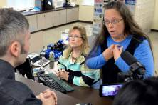 Rowan County Clerk Kim Davis, right, talks with David Moore following her office's refusal to issue marriage licenses at the Rowan County Courthouse in Morehead, Ky., Tuesday, Sept. 1, 2015. Although her appeal to the U.S. Supreme Court was denied, Davis still refuses to issue marriage licenses. (AP Photo/Timothy D. Easley)