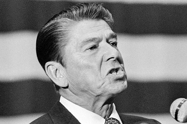 "Republican presidential candidate Ronald Reagan angrily gestures during a speech before the Colorado state GOP convention in Fort Collins, Colorado on July 10, 1976. Reagan, talking about the Federal deficit said: ""The federal government is going deeper into debt these past few years than anytime our history"". He followed President Fords' son Jack to the podium as both Ford and Reagan are seeking the support of the 26 uncommitted delegates to the National GOP convention. (AP Photo/BR)"