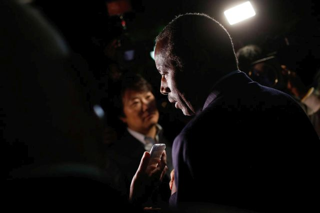 ALEXANDRIA, UNITED STATES - OCTOBER 16: Republican presidential candidate Dr. Ben Carson answers questions from members of the press after delivering brief remarks to supporters at the King Street Retail Walk October 16, 2015 in Alexandria, Virginia. Carson discussed threats facing the United States during his remarks. (Photo by Win McNamee/Getty Images)