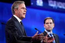 Republican U.S. presidential candidate former Governor Jeb Bush speaks as U.S. Senator Marco Rubio (R) looks on at the 2016 U.S. Republican presidential candidates debate held by CNBC in Boulder, Colorado, October 28, 2015. REUTERS/Rick Wilking - RTX1TQ0L