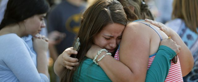 Jessica Vazquez, left, hugs her aunt, Leticia Acaraz, as they await word on Acaraz's daughter after a deadly shooting at Umpqua Community College, in Roseburg, Ore., on Thursday, Oct. 1, 2015. (Andy Nelson/The Register-Guard via AP) MANDATORY CREDIT