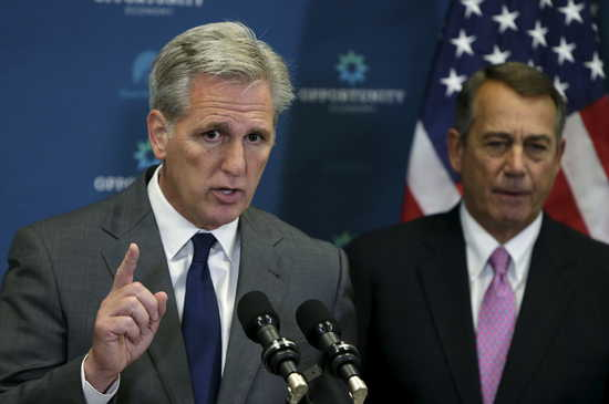 House Speaker John Boehner (R-OH) (R) and House Majority leader Kevin McCarthy (R-CA) (L) speak to reporters at a news conference on Capitol Hill in Washington October 7, 2015. McCarthy is vying for Boehner's House Speaker position at the end of the month. REUTERS/Gary Cameron - RTS3F0K