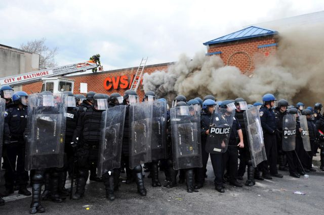 April 27, 2015 - Baltimore, Maryland, U.S. - Looting and rioting broke out at North and Pennsylvania Avenues where a CVS was set on fire. At least 15 police officers were injured Monday afternoon during clashes with protesters over the death of Freddie Gray, a 25-year-old black man who died of injuries sustained during an arrest. The governor of Maryland has declared a state of emergency and activated the National Guard to help with the violence and rioting. (Credit Image: © Algerina Perna/TNS/ZUMA Wire)
