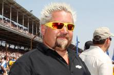 Celebrity chef Guy Fieri, the honorary pace car driver, awaits the start of the Indianapolis 500 auto race at the Indianapolis Motor Speedway in Indianapolis, Indiana, May 27, 2012. REUTERS/Matt Sullivan (UNITED STATES - Tags: SPORT MOTORSPORT) - RTR32PJD
