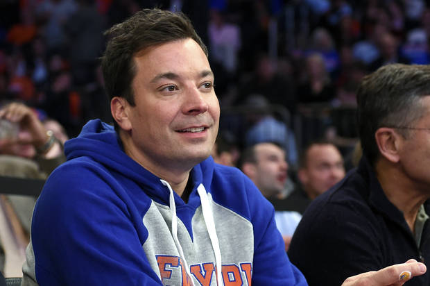Jimmy Fallon, actor, comedian and host of The Tonight Show watches the New York Knicks play an NBA basketball game against the Atlanta Hawks on Thursday, Oct. 29, 2015, in New York. (AP Photo/Kathy Kmonicek)