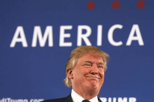 In this Oct. 26, 2015, photo, Republican presidential candidate Donald Trump smiles as he receives applause after speaking at a town hall meeting at Atkinson Country Club in Atkinson, N.H. Trump and the other Republican president candidates get ready for the third GOP on Oct. 28, in Boulder, Colo. (AP Photo/Cheryl Senter)