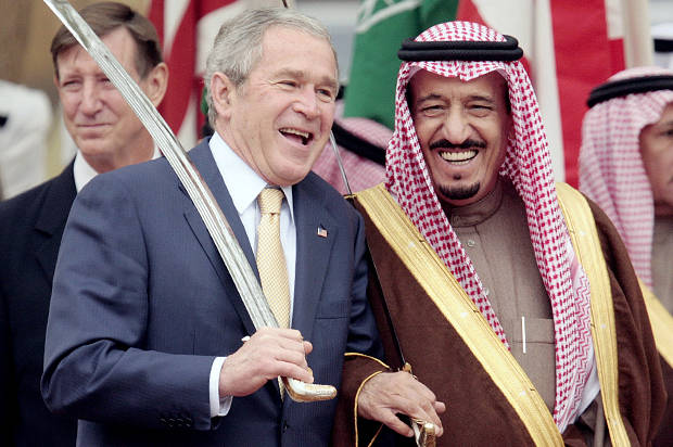 U.S. President George W. Bush (L) and Saudi Arabia's Prince Salman Bin Abdul Aziz, brother of King Abdullah, watch a traditional celebration dance outside the Al Murabba Palace in Riyadh, Saudi Arabia, January 15, 2008. REUTERS/Larry Downing (SAUDI ARABIA) - RTR1VTNK